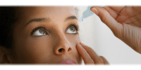 Patient putting in drops for dry eye
